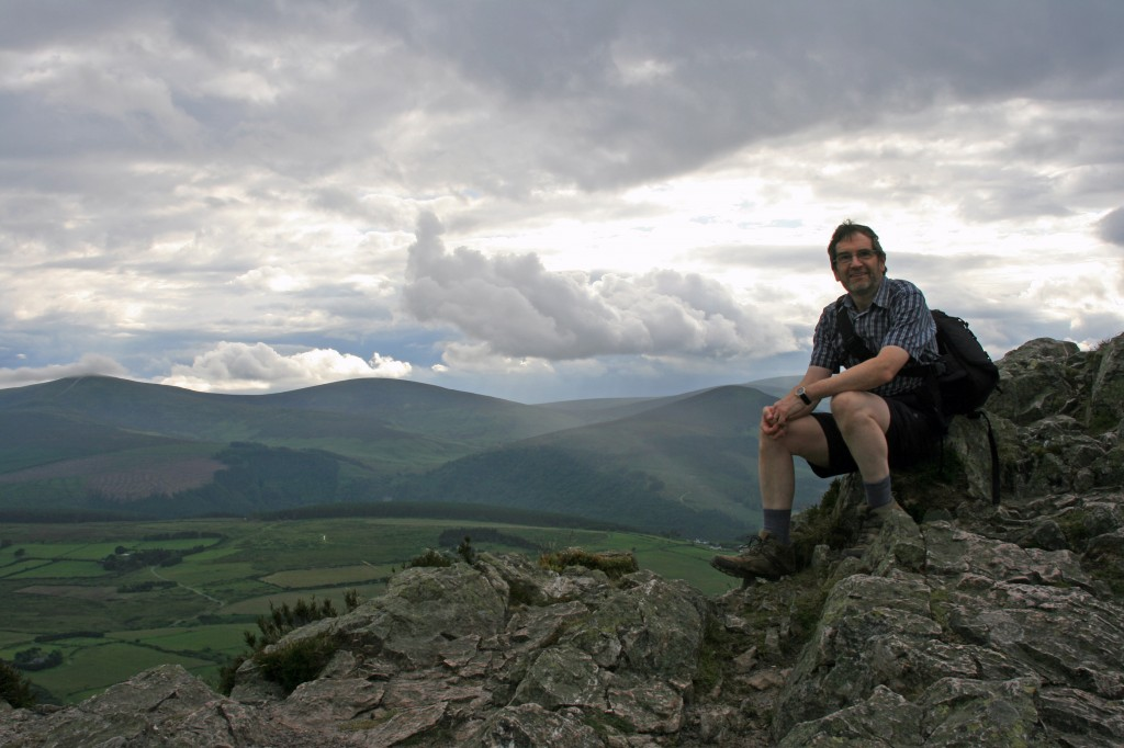 David on top of the Great Sugar Loaf - Wicklow Hills behind
