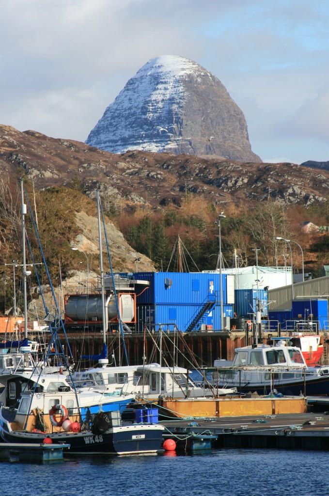 Suilven's crazy summit looms above Lochinver harobour