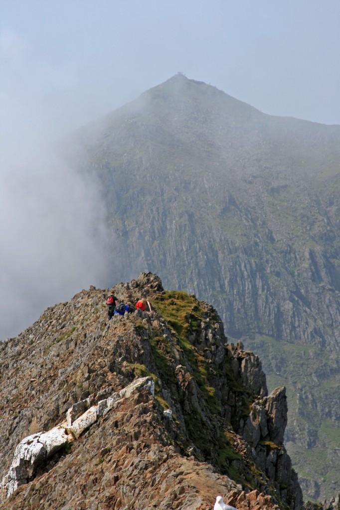 along the ridge of Crib Goch, with Yr Wyddfa the dramatic backdrop
