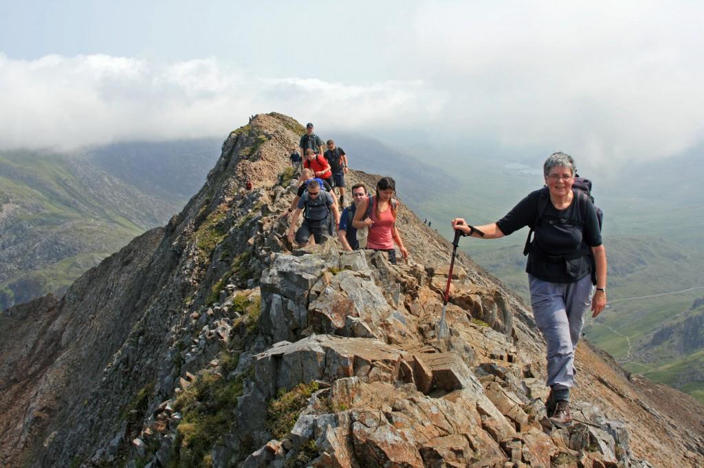 Anne makes her way along the ridge;  summit of Crib Goch behind