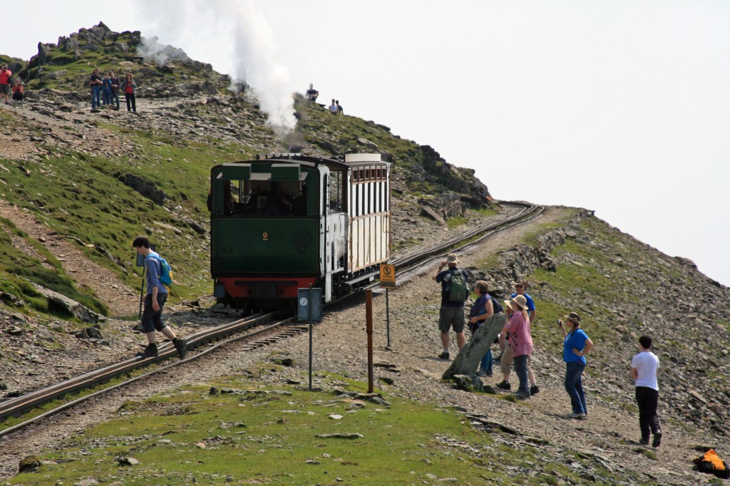 train crosses the main path, and continues up towards the summit station